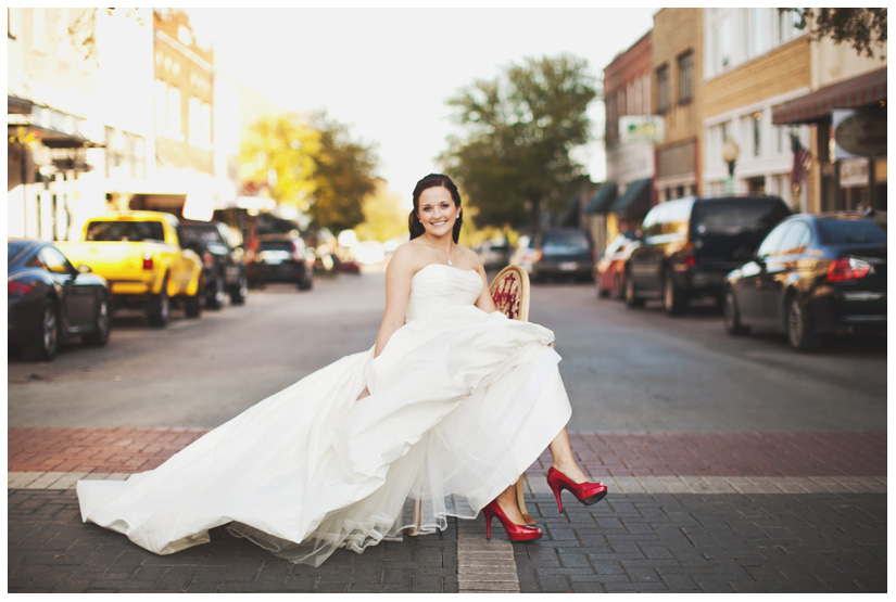 Bridal photo portrait session of Hannah Petkovsik with red high heels shoes in historic downtown McKinney Texas by Dallas wedding photographer Stacy Reeves