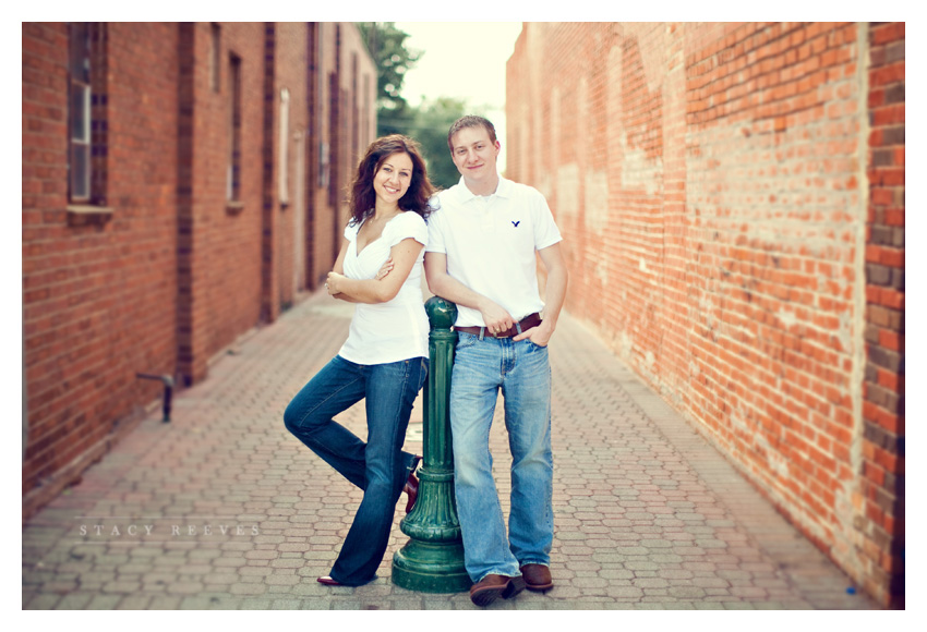 engagement session photos of Julie Lasater and Colin Beal in historic downtown Grapevine near Main Street by Dallas wedding photographer Stacy Reeves