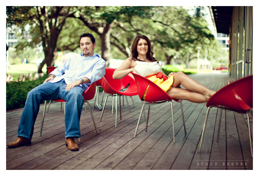 Engagement photos of Jamie Riley and Garrett Roy at Discovery Green Park in downtown Houston by Dallas wedding photographer Stacy Reeves
