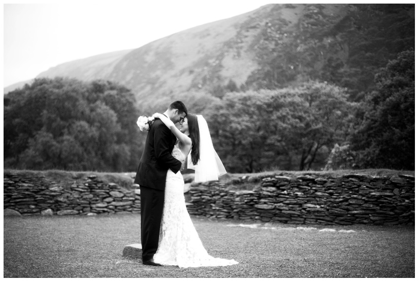 bride and groom in ancient druid stone circle in Wicklow Mountains near Dublin Ireland after eloping