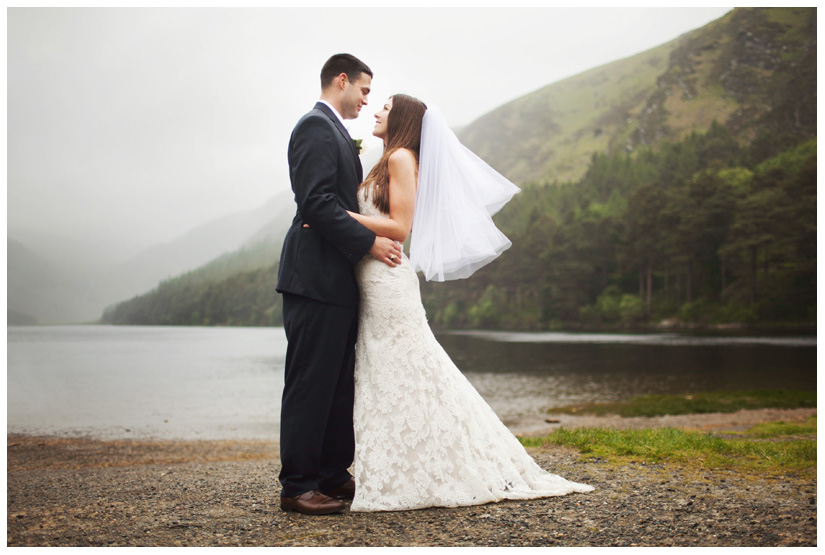 portraits of bride and groom in the wind and rain after wedding day ceremony in the Irish mountains by Stacy Reeves