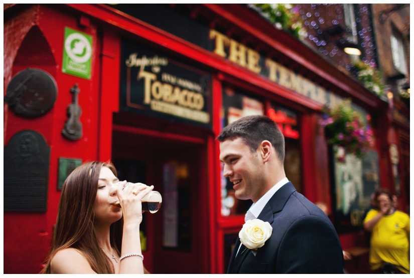 bride drinking Guinness at her wedding in Dublin Ireland